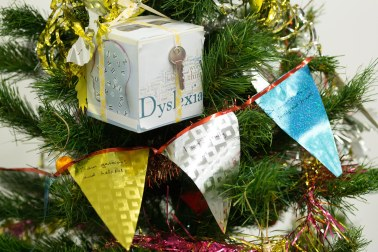 A box and bunting hung on the IDDP Christmas tree