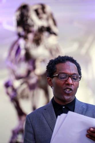 Lemn Sissay MBE, Chancellor of The University of Manchester, addressing guests in The Manchester Museum's Fossils Gallery