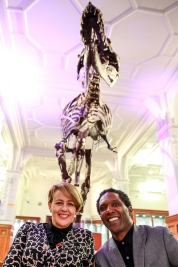 Tanni and Lemn posing for a photo with Stan The T-Rex