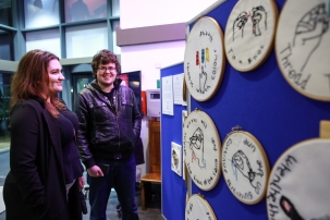 Guests enjoying the arts exhibition by Venture Arts in the Martin Harris Centre foyer